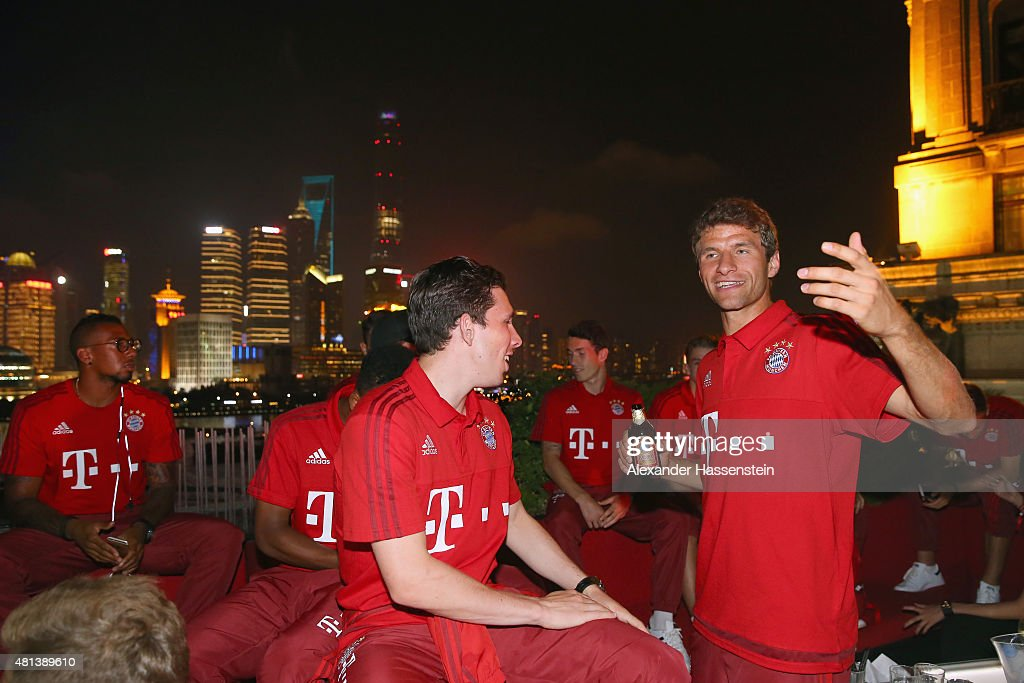 <a gi-track='captionPersonalityLinkClicked' href=/galleries/search?phrase=Thomas+Mueller&family=editorial&specificpeople=5842906 ng-click='$event.stopPropagation()'>Thomas Mueller</a> (R) of FC Bayern Muenchen smiles with his team mate Pierre-Emile Hojbjerg at the Audi quattro Cup 2015 Night Gala at Bar Rouge Shanghai The Bund during day 4 of the FC Bayern Audi China Summer Pre-Season Tour on July 20, 2015 in Shanghai, China.