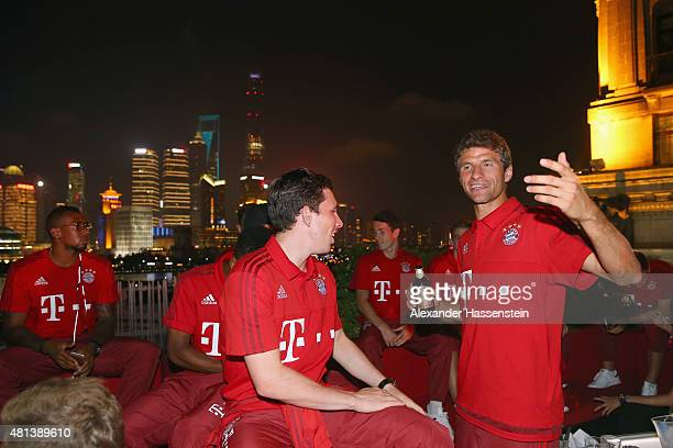 Thomas Mueller of FC Bayern Muenchen smiles with his team mate PierreEmile Hojbjerg at the Audi quattro Cup 2015 Night Gala at Bar Rouge Shanghai The...