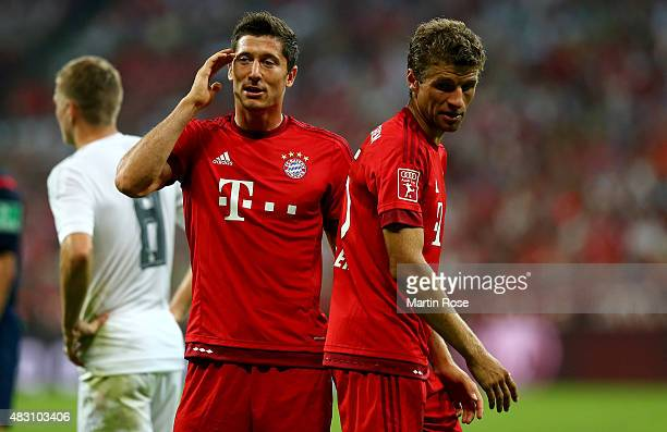 Thomas Mueller of FC Bayern Muenchen talks to team mate Robert Lewandowski during the Audi Cup 2015 final match between FC Bayern Muenchen and Real...