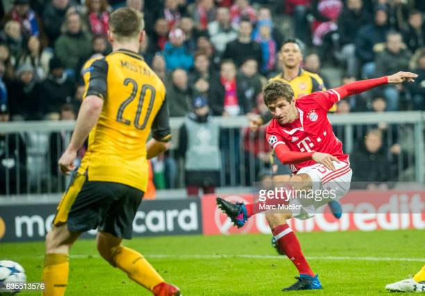 Thomas Mueller of FC Bayern Munic scores the fifth goal during the UEFA Champions League Round of 16 first leg match between FC Bayern Muenchen and...