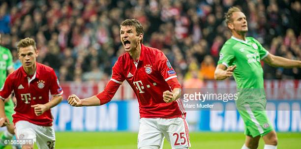 Thomas Mueller of FC Bayern Munich celebrates the opening goal during the UEFA Champions League group D match between Bayern Munich and PSV Eindhoven...