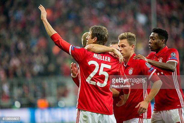 Thomas Mueller of FC Bayern Munich celebrates the opening goal with team mates during the UEFA Champions League group D match between Bayern Munich...