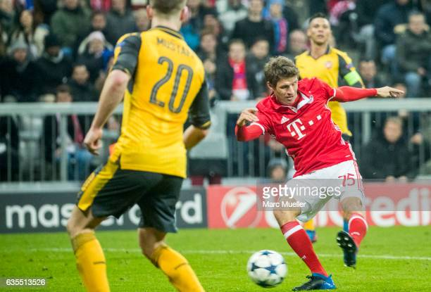 Thomas Mueller of FC Bayern Munich scores the fifth goal during the UEFA Champions League Round of 16 first leg match between FC Bayern Muenchen and...