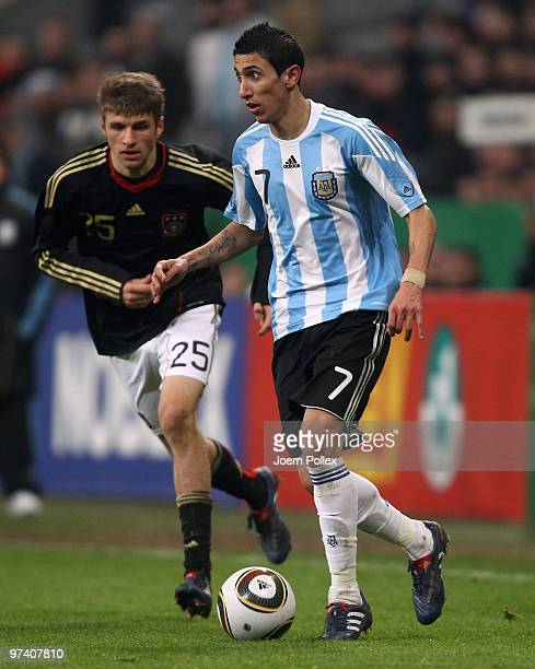 Thomas Mueller of Germany and Angel Di Maria of Argentina battle for the ball during the International Friendly match between Germany and Argentina...