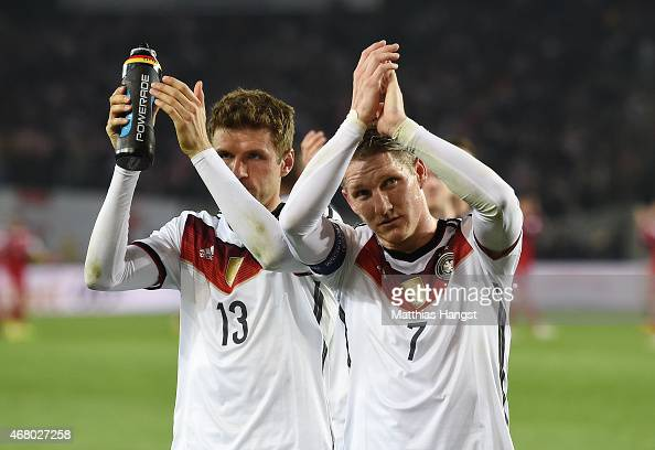 Thomas Mueller of Germany and Bastian Schweinsteiger of Germany applause the fans after the EURO 2016 Group D Qualifier match between Georgia and...