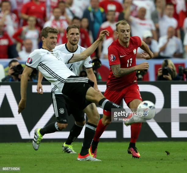 Thomas Mueller of Germany and Benedikt Hoewedes of Germany and Kamil Grosicki of Poland battle for the ball during the UEFA EURO 2016 Group C match...