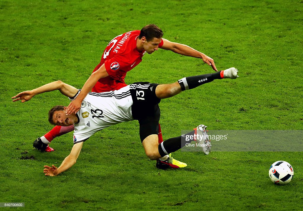 Thomas Mueller of Germany and Grzegorz Krychowiak of Poland compete for the ball during the UEFA EURO 2016 Group C match between Germany and Poland at Stade de France on June 16, 2016 in Paris, France.