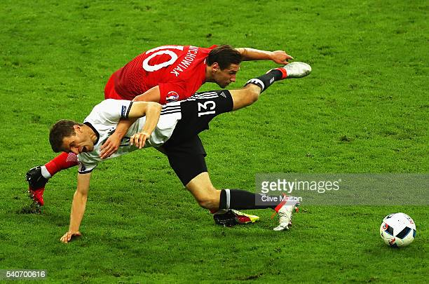Thomas Mueller of Germany and Grzegorz Krychowiak of Poland compete for the ball during the UEFA EURO 2016 Group C match between Germany and Poland...