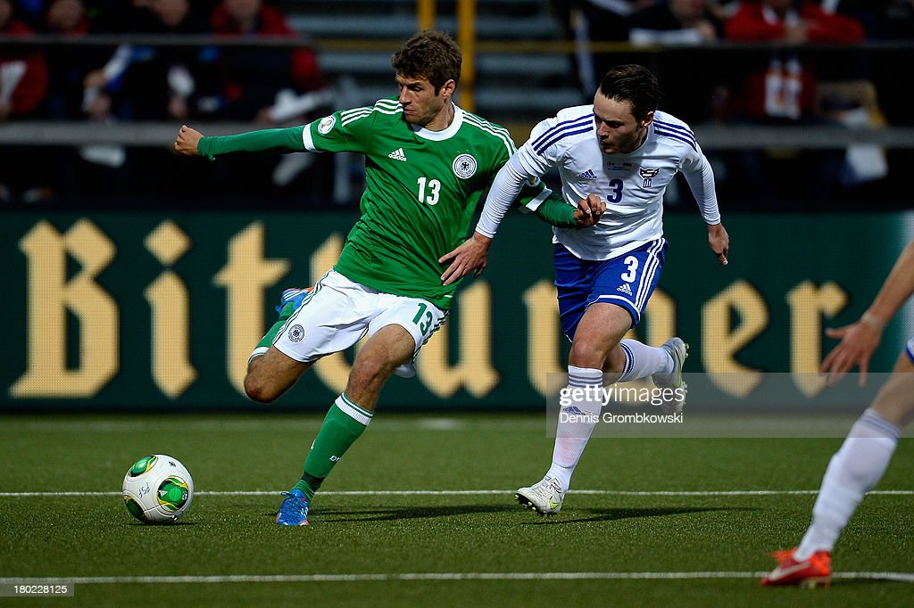 Thomas Mueller of Germany and Viljormur Davidsen of Faeroe Islands battle for the ball during the FIFA 2014 World Cup Qualifier match between Faeroe Islands and Germany on September 10, 2013 in Torshavn, Denmark.