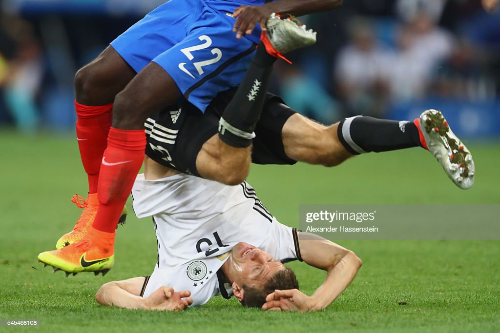 Thomas Mueller of Germany battles for the ball with Samuel Umtiti of France during the UEFA EURO 2016 semi final match between Germany and France at Stade Velodrome on July 7, 2016 in Marseille, France.