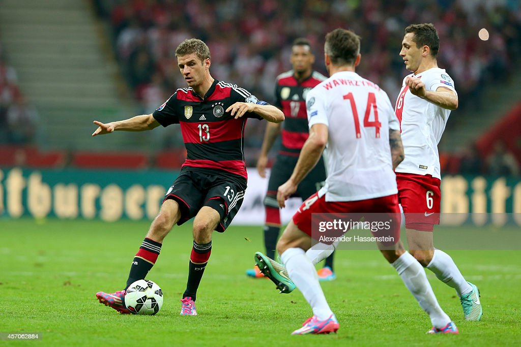 <a gi-track='captionPersonalityLinkClicked' href=/galleries/search?phrase=Thomas+Mueller&family=editorial&specificpeople=5842906 ng-click='$event.stopPropagation()'>Thomas Mueller</a> (L) of Germany battles for the ball with <a gi-track='captionPersonalityLinkClicked' href=/galleries/search?phrase=Tomasz+Jodlowiec&family=editorial&specificpeople=5700915 ng-click='$event.stopPropagation()'>Tomasz Jodlowiec</a> (R) of Poland and his team mate <a gi-track='captionPersonalityLinkClicked' href=/galleries/search?phrase=Jakub+Wawrzyniak&family=editorial&specificpeople=4666843 ng-click='$event.stopPropagation()'>Jakub Wawrzyniak</a> (C) during of the EURO 2016 Group D qualifying match between Poland and Germany at Narodowy Stadium on October 11, 2014 in Warsaw, Poland.