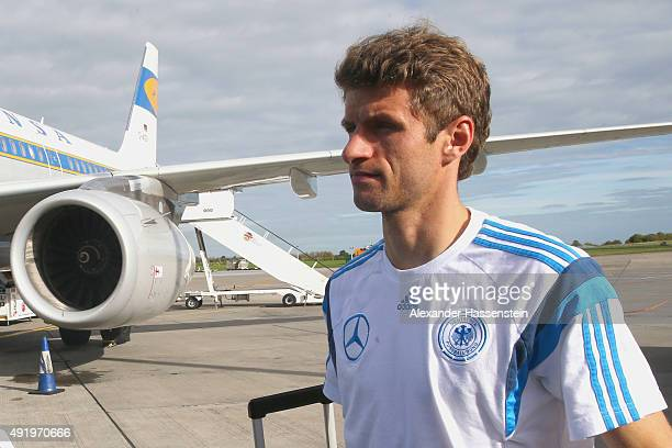 Thomas Mueller of Germany boards for the team charter to Leipzig at Dublin airport on October 9 2015 in Dublin Ireland