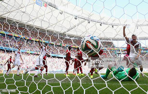 Thomas Mueller of Germany celebrates as teammate Mats Hummels scores his team's second goal on a header past Rui Patricio of Portugal during the 2014...