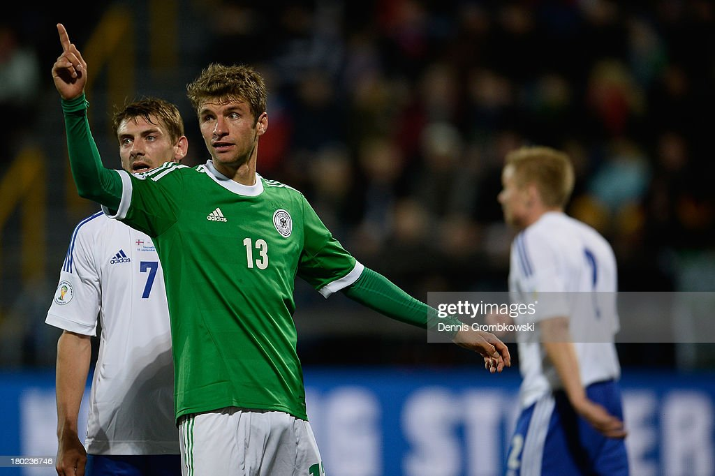 Thomas Mueller of Germany celebrates his team's third goal during the FIFA 2014 World Cup Qualifier match between Faeroe Islands and Germany on September 10, 2013 in Torshavn, Denmark.