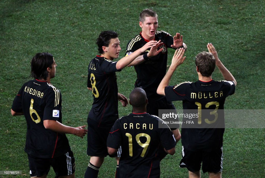 Thomas Mueller of Germany celebrates scoring his side's first goal with team mates Sami Khedira, Mesut Oezil, Cacau and Bastian Schweinsteiger during the 2010 FIFA World Cup South Africa Third Place Play-off match between Uruguay and Germany at The Nelson Mandela Bay Stadium on July 10, 2010 in Port Elizabeth, South Africa.