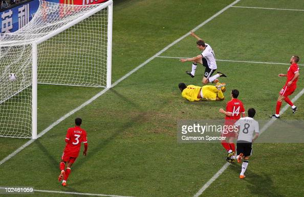 Thomas Mueller of Germany celebrates scoring his side's third goal past David James of England during the 2010 FIFA World Cup South Africa Round of...
