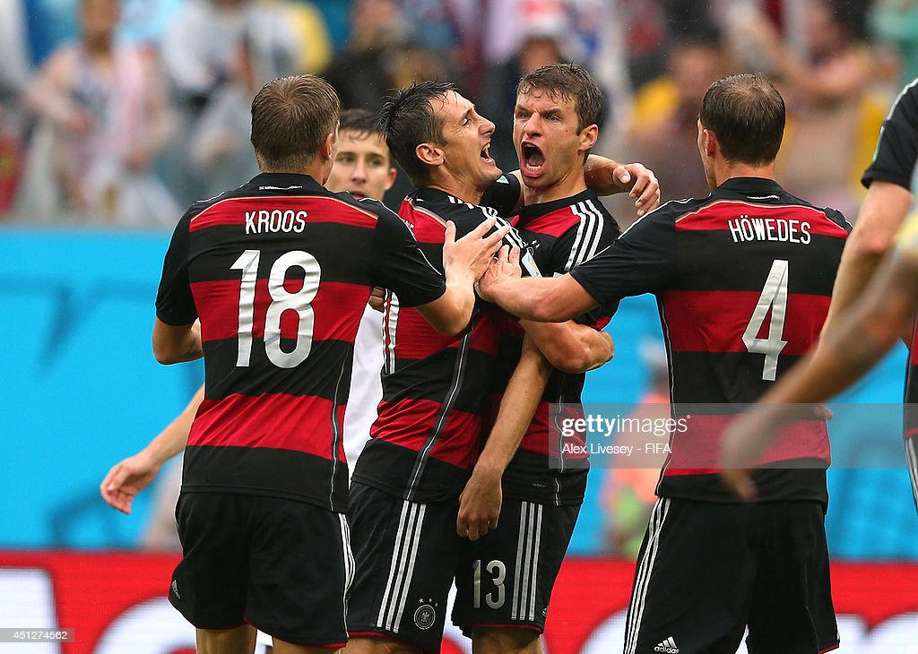 <a gi-track='captionPersonalityLinkClicked' href=/galleries/search?phrase=Thomas+Mueller&family=editorial&specificpeople=5842906 ng-click='$event.stopPropagation()'>Thomas Mueller</a> (2nd R) of Germany celebrates scoring his team's first goal with his teammates Benedikt Hoewedes (1st R), <a gi-track='captionPersonalityLinkClicked' href=/galleries/search?phrase=Miroslav+Klose&family=editorial&specificpeople=206489 ng-click='$event.stopPropagation()'>Miroslav Klose</a> (2nd L) and Toni Kroos (1st L) during the 2014 FIFA World Cup Brazil Group G match between USA and Germany at Arena Pernambuco on June 26, 2014 in Recife, Brazil.