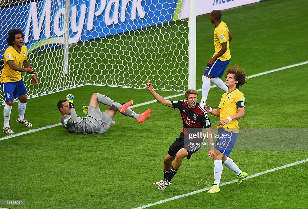 <a gi-track='captionPersonalityLinkClicked' href=/galleries/search?phrase=Thomas+Mueller&family=editorial&specificpeople=5842906 ng-click='$event.stopPropagation()'>Thomas Mueller</a> of Germany celebrates scoring his team's first goal past Julio Cesar of Brazil during the 2014 FIFA World Cup Brazil Semi Final match between Brazil and Germany at Estadio Mineirao on July 8, 2014 in Belo Horizonte, Brazil.