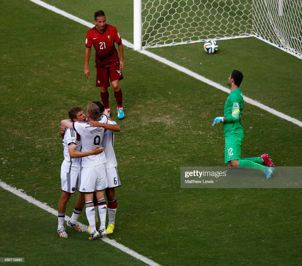 Thomas Mueller of Germany (L) celebrates scoring his team's fourth goal and completing his hat trick with Andre Schuerrle and Sami Khedira as Joao Pereira and goalkeeper Rui Patricio of Portugal look on during the 2014 FIFA World Cup Brazil Group G match between Germany and Portugal at Arena Fonte Nova on June 16, 2014 in Salvador, Brazil.