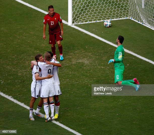 Thomas Mueller of Germany celebrates scoring his team's fourth goal and completing his hat trick with Andre Schuerrle and Sami Khedira as Joao...