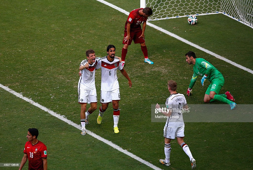Thomas Mueller of Germany (2nd L) celebrates scoring his team's fourth goal and completing his hat trick with Sami Khedira and Andre Schuerrle as Joao Pereira and goalkeeper Rui Patricio of Portugal look on during the 2014 FIFA World Cup Brazil Group G match between Germany and Portugal at Arena Fonte Nova on June 16, 2014 in Salvador, Brazil.