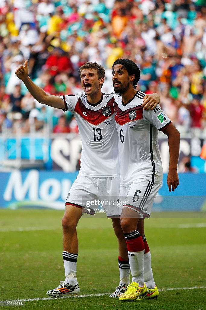 Thomas Mueller of Germany (L) celebrates scoring his team's fourth goal and completing his hat trick with Sami Khedira during the 2014 FIFA World Cup Brazil Group G match between Germany and Portugal at Arena Fonte Nova on June 16, 2014 in Salvador, Brazil.