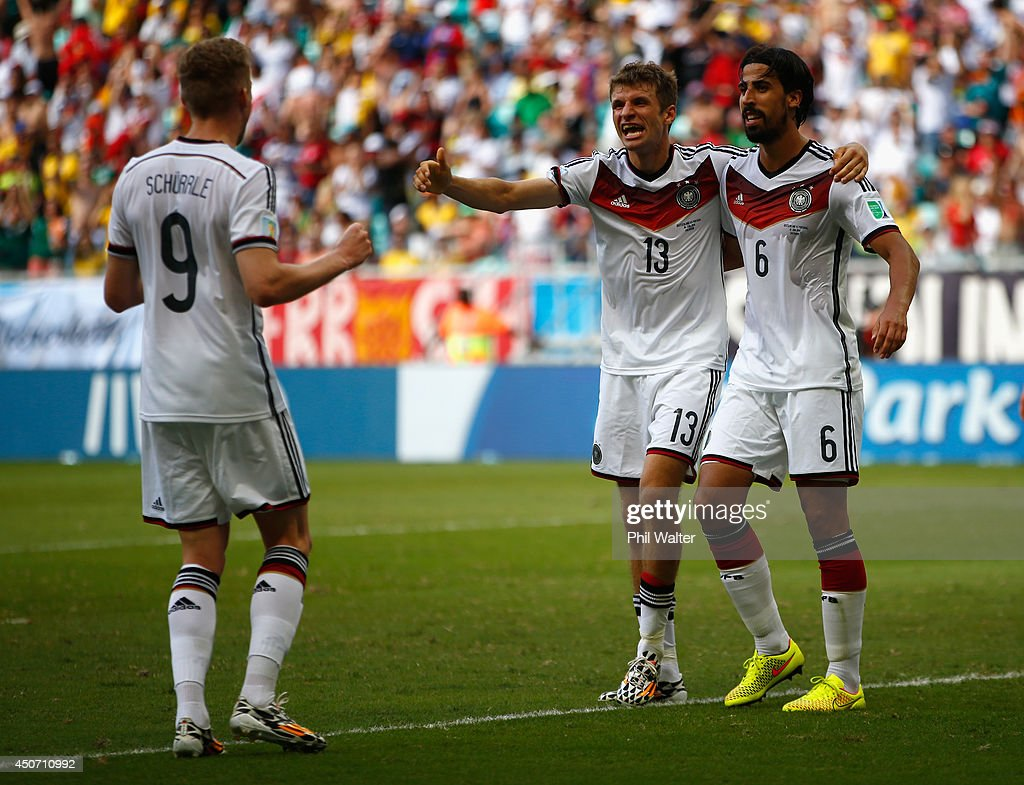 Thomas Mueller of Germany (C) celebrates scoring his team's fourth goal and completing his hat trick with Andre Schuerrle (L) and Sami Khedira (R) during the 2014 FIFA World Cup Brazil Group G match between Germany and Portugal at Arena Fonte Nova on June 16, 2014 in Salvador, Brazil.