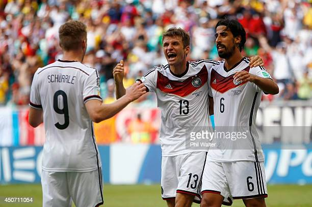 Thomas Mueller of Germany celebrates scoring his team's fourth goal and completing his hat trick with Andre Schuerrle and Sami Khedira during the...