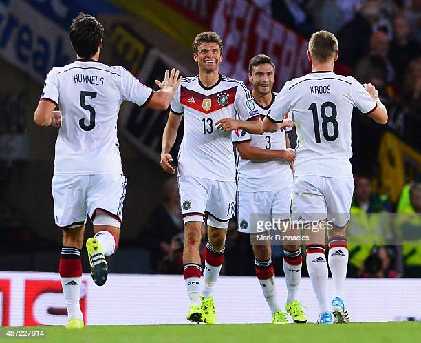 Thomas Mueller of Germany celebrates scoring his teams opening goal with team mates during the UEFA EURO 2016 Qualifier Group D match between...