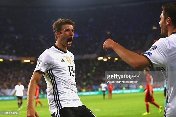Thomas Mueller of Germany celebrates scoring the 3rd goal with his team mate Jonas Hector during the 2018 FIFA World Cup Qualifier match between...