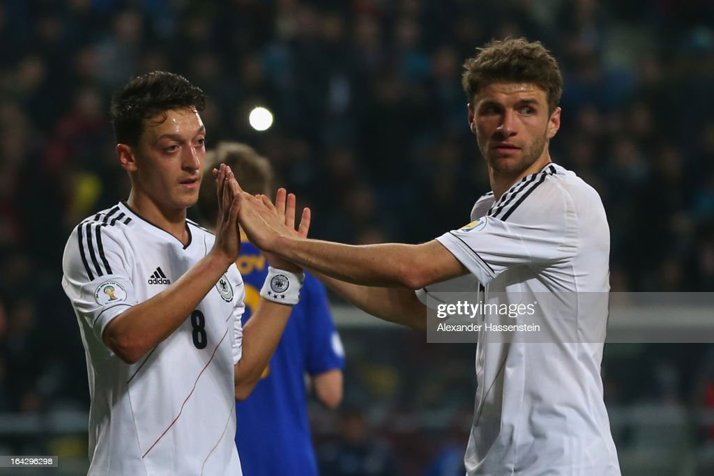 Thomas Mueller (R) of Germany celebrates scoring the 4th team goal with his team mate Mesut Oezil during the FIFA 2014 World Cup qualifier group C match between Kazakhstan and Germany at Astana Arena on March 22, 2013 in Astana, Kazakhstan.