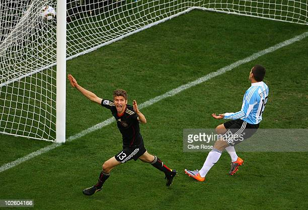 Thomas Mueller of Germany celebrates scoring the opening goal during the 2010 FIFA World Cup South Africa Quarter Final match between Argentina and...