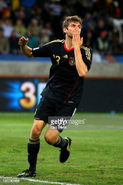 Thomas Mueller of Germany celebrates scoring the opening goal during the 2010 FIFA World Cup South Africa Third Place Playoff match between Uruguay...