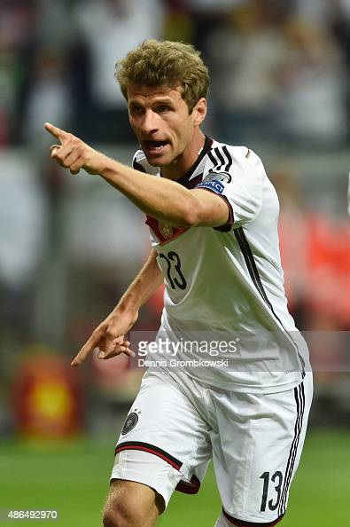 Thomas Mueller of Germany celebrates scoring the opening goal during the EURO 2016 Qualifier Group D match between Germany and Poland at...