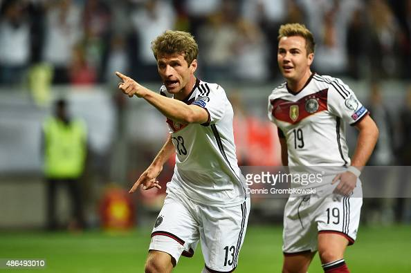 Thomas Mueller of Germany celebrates scoring the opening goal with Mario Goetze during the EURO 2016 Qualifier Group D match between Germany and...