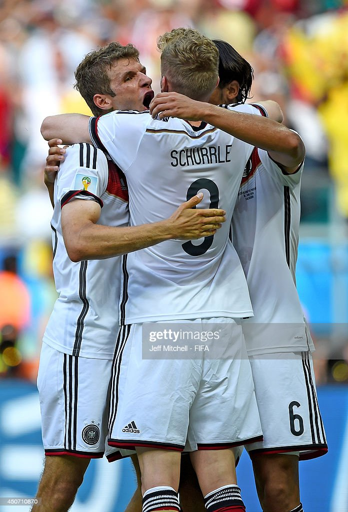 Thomas Mueller of Germany (L) celebrates with Andre Schuerrle of Germany after scoring the team's fourth goal during the 2014 FIFA World Cup Brazil Group G match between Germany and Portugal at Arena Fonte Nova on June 16, 2014 in Salvador, Brazil.