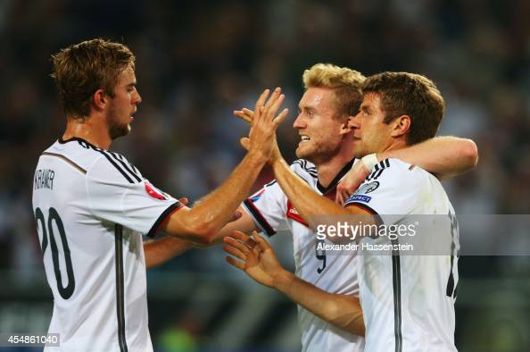 Thomas Mueller of Germany celebrates with Christoph Kramer and Andre Schuerrle as he scores their first goal with a header during the EURO 2016 Group...
