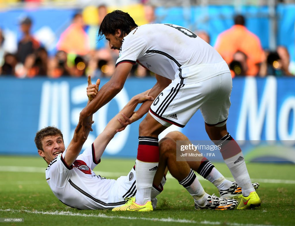 Thomas Mueller of Germany (L) celebrates with Sami Khedira of Germany after scoring the team's fourth goal during the 2014 FIFA World Cup Brazil Group G match between Germany and Portugal at Arena Fonte Nova on June 16, 2014 in Salvador, Brazil.