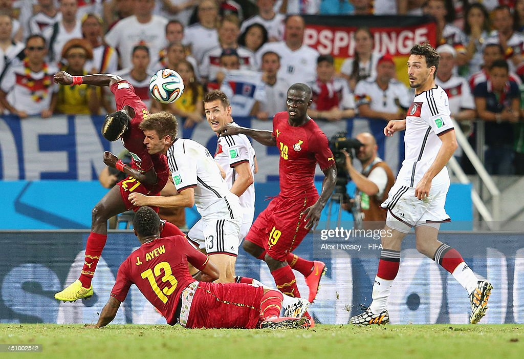 <a gi-track='captionPersonalityLinkClicked' href=/galleries/search?phrase=Thomas+Mueller&family=editorial&specificpeople=5842906 ng-click='$event.stopPropagation()'>Thomas Mueller</a> of Germany collides with <a gi-track='captionPersonalityLinkClicked' href=/galleries/search?phrase=John+Boye&family=editorial&specificpeople=7190220 ng-click='$event.stopPropagation()'>John Boye</a> of Ghana during the 2014 FIFA World Cup Brazil Group G match between Germany and Ghana at Castelao on June 21, 2014 in Fortaleza, Brazil.