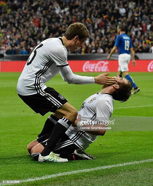 Thomas Mueller of Germany congratulates Mario Goetze after he scored the second goal during the International Friendly match between Germany and...