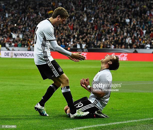 Thomas Mueller of Germany congratulates Mario Goetze of Germany after he scored the second goal during the International Friendly match between...