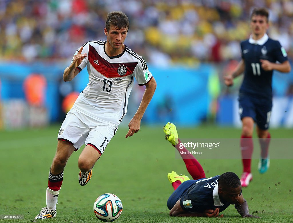 Thomas Mueller of Germany controls the ball as <a gi-track='captionPersonalityLinkClicked' href=/galleries/search?phrase=Patrice+Evra&family=editorial&specificpeople=714865 ng-click='$event.stopPropagation()'>Patrice Evra</a> of France lies on the pitch during the 2014 FIFA World Cup Brazil Quarter Final match between France and Germany at Maracana on July 4, 2014 in Rio de Janeiro, Brazil.