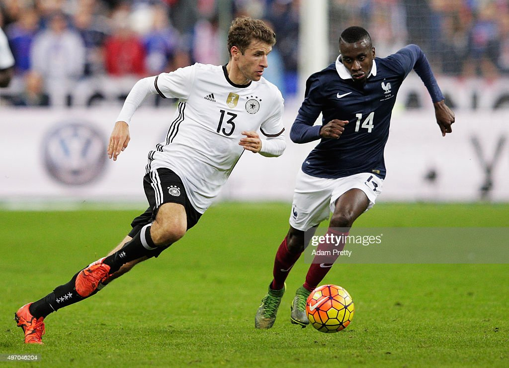 Thomas Mueller of Germany is challenged by <a gi-track='captionPersonalityLinkClicked' href=/galleries/search?phrase=Blaise+Matuidi&family=editorial&specificpeople=801779 ng-click='$event.stopPropagation()'>Blaise Matuidi</a> of France during the International Friendly match between France and Germany at the Stade de France on November 13, 2015 in Paris, France.