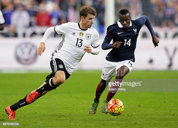 Thomas Mueller of Germany is challenged by Blaise Matuidi of France during the International Friendly match between France and Germany at the Stade...