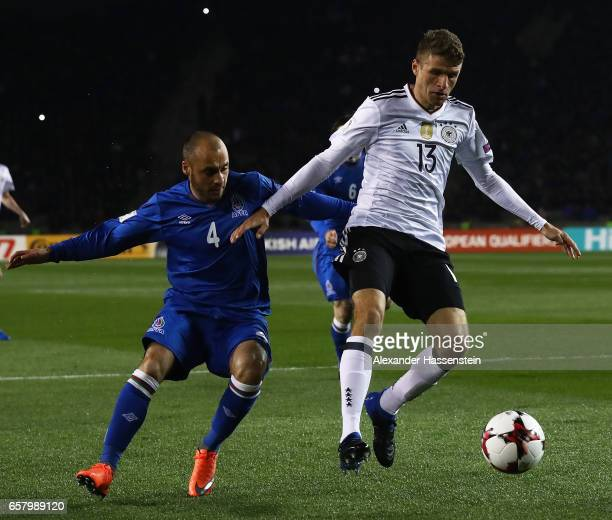 Thomas Mueller of Germany is challenged by Pavlo Pashayev of Azerbaijan during the FIFA 2018 World Cup Qualifing Group C between Azerbaijan and...