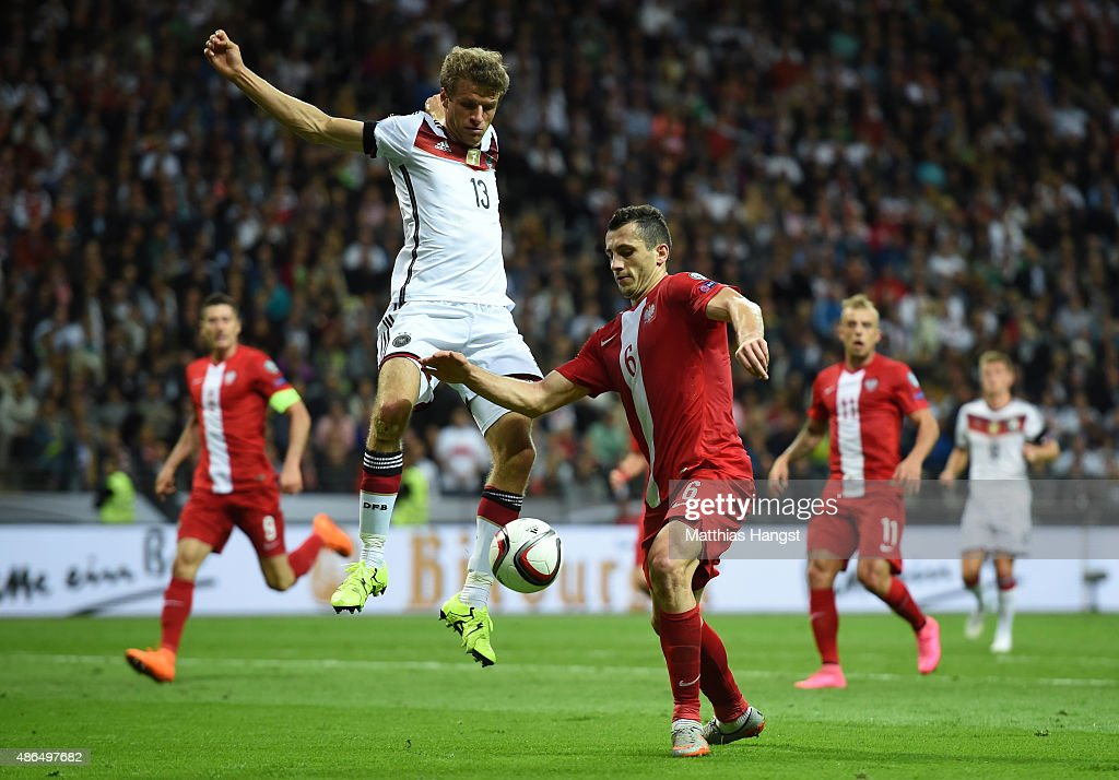 <a gi-track='captionPersonalityLinkClicked' href=/galleries/search?phrase=Thomas+Mueller&family=editorial&specificpeople=5842906 ng-click='$event.stopPropagation()'>Thomas Mueller</a> of Germany is challenged by <a gi-track='captionPersonalityLinkClicked' href=/galleries/search?phrase=Tomasz+Jodlowiec&family=editorial&specificpeople=5700915 ng-click='$event.stopPropagation()'>Tomasz Jodlowiec</a> of Poland during the EURO 2016 Qualifier Group D match between Germany and Poland at Commerzbank-Arena on September 4, 2015 in Frankfurt am Main, Germany.
