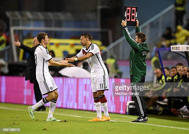 Thomas Mueller of Germany is substituted for Karim Bellarabi of Germany after suffering an injury during the International Friendly match between...