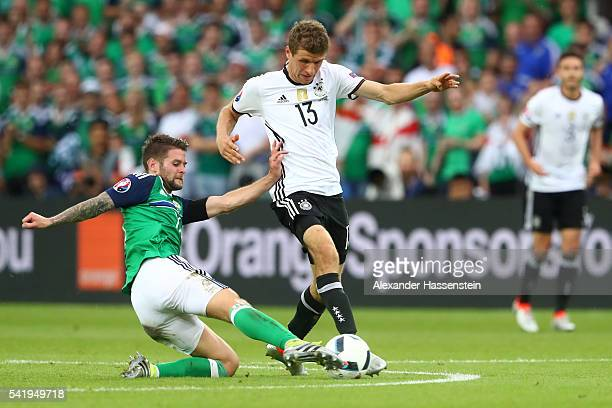 Thomas Mueller of Germany is tackled by Oliver Norwood of Northern Ireland during the UEFA EURO 2016 Group C match between Northern Ireland and...