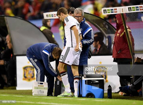 Thomas Mueller of Germany is treated at the edge of the pitch after suffering an injury during the International Friendly match between Spain and...