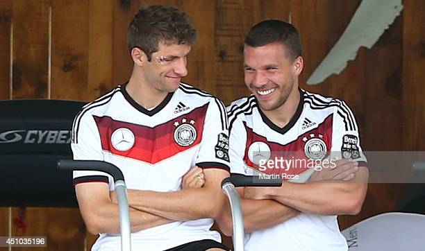 Thomas Mueller of Germany jokes with team mate Lukas Podolski during the German national team training at Campo Bahia on June 22 2014 in Santo Andre...